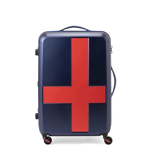 ネイビーのボディに赤いクロス模様が施されたスーツケース