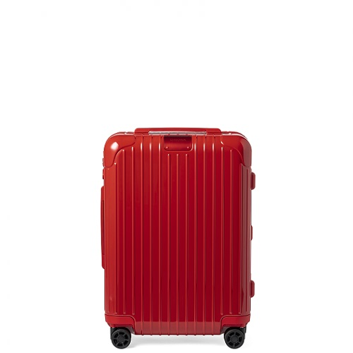 光沢のある赤色のスーツケース