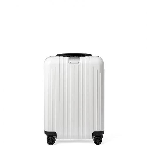 光沢のある白いスーツケース