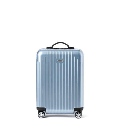 光沢のある水色のスーツケース