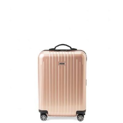 淡いピンクのスーツケース