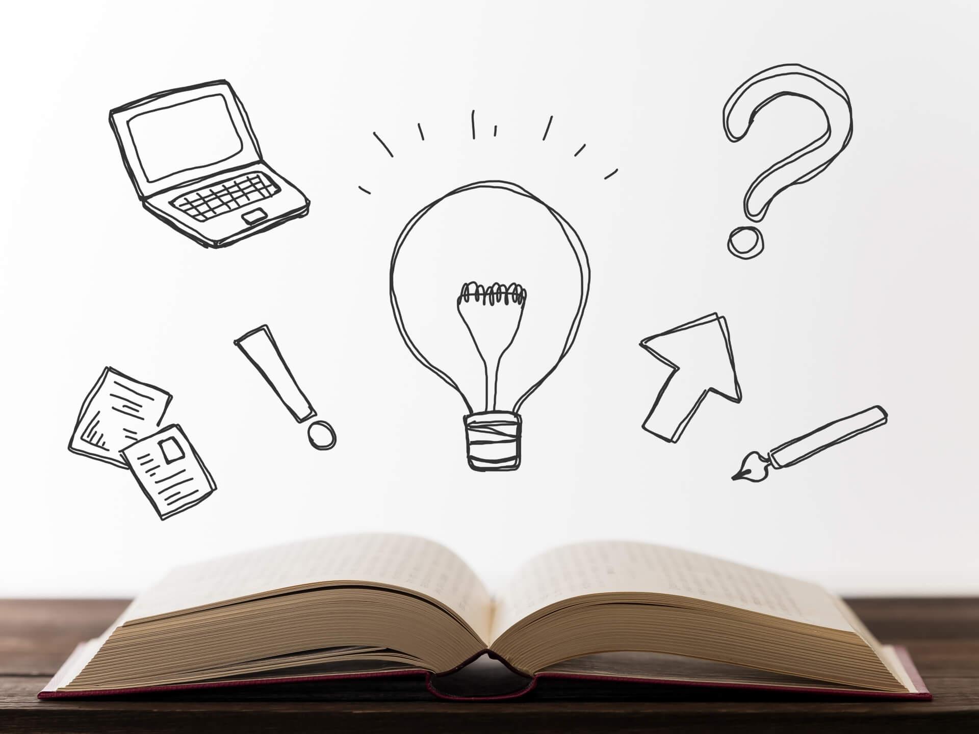 買取してもらえるスーツケースの特徴は何か。開いた本から飛び出す大きな光る電球のイラスト