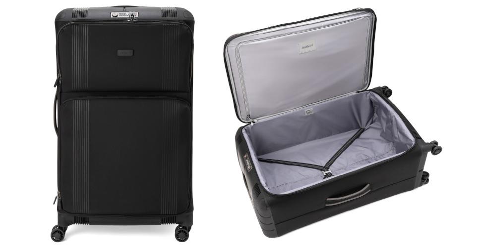 長期出張に必要な持ち物。立てた状態と寝かせて開けた状態の黒いスーツケース。